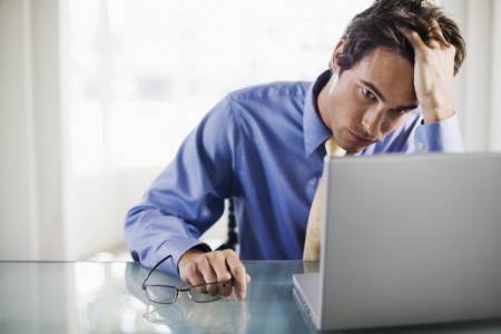 Frustrated-businessman-with-laptop-computer
